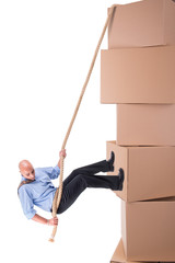 Businessman climbing boxes