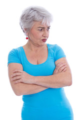 Ältere Frau isoliert mit skeptischem Blick