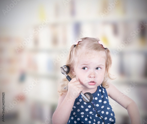 curly-haired little girl with a vintage telephone