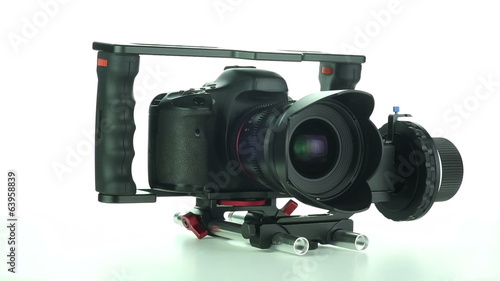DSLR camera rotates on a white background