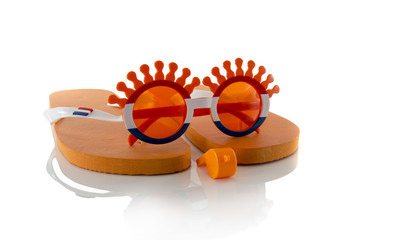 plastic glasses horn flute slippers  and flag in orange