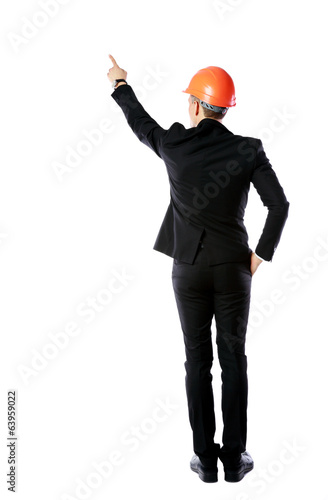 businessman in protective helmet directing works