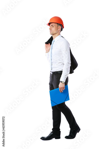 Pensive businessman in helmet with blue folder