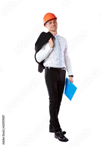Businessman in helmet with blue folder over white background
