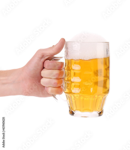 Male hand holding up a glass of beer.