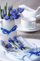 Festive table setting with blue flowers closeup