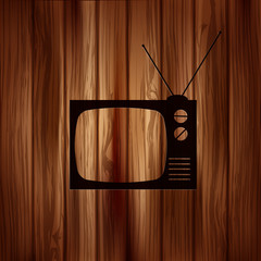 Retro tv icon. Wooden background.