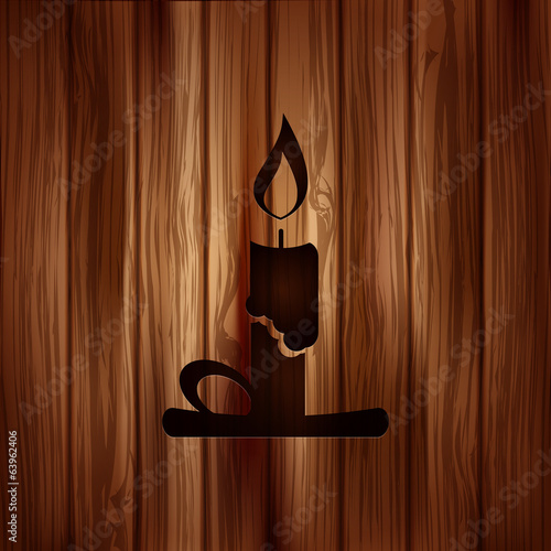 Candle web icon. Wooden background.