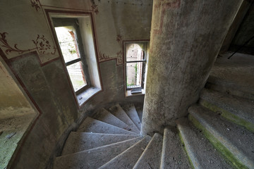 Old spiral staircase in abandoned castle