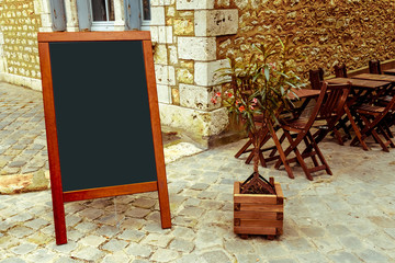 street view of a Restaurant's terrace with blackboard