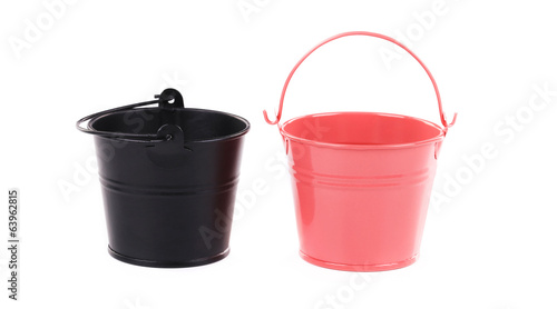 Black and pink metal buckets.