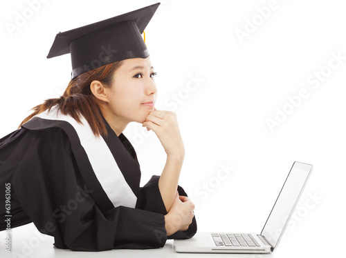 female graduation thinking about career or job