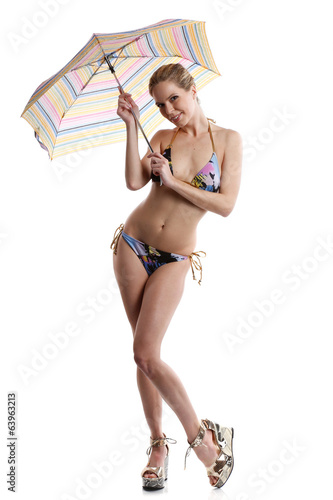 woman in bikini or swimwear with umbrella