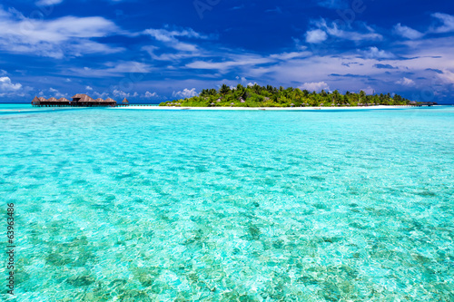 Foto op Canvas Groene koraal Tropical Island and over water bungalows