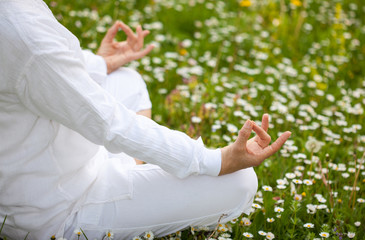yoga on the grass with white flowers