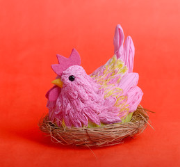 easter hen on red background
