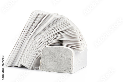 Stack of folded disposable papers.