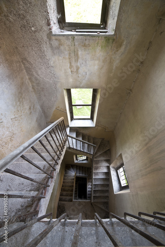 Old spiral staircase in abandoned house