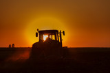 Tractor Plowing in dusk on sunset with crows Kanvas Tablo