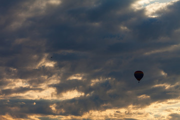 Silhouette of balloon in the sky with clouds