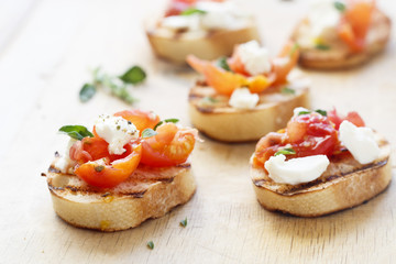 Tomatoes, oregano and feta crostini