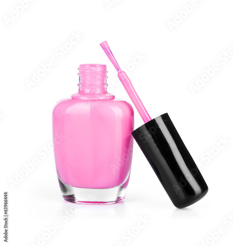 pink nail polish with brush on an isolated white background