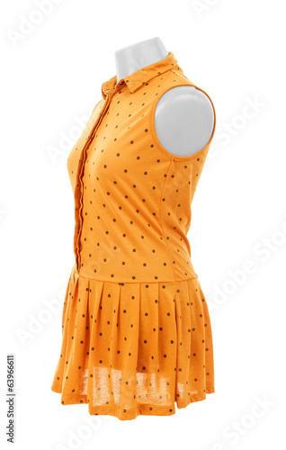 yellow dress on a hanger on a white background