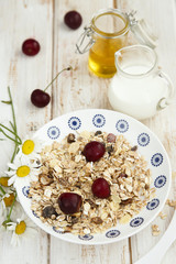 Granola with fresh cherries