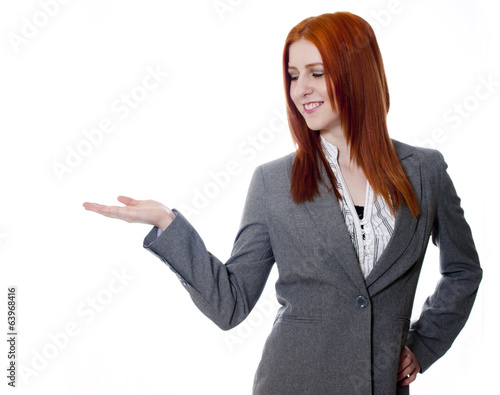 Young business woman on white background, hand out, palm up