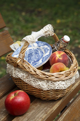 Picnic basket with fruits and homemade wine