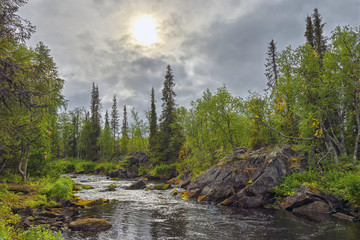 Mystical landscape on the river Polisarke. Kola Peninsula.
