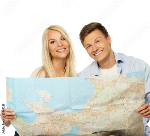 Smiling beautiful young couple with a map