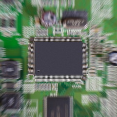 Zoom effect on microchip mounted in a printed circuit board.