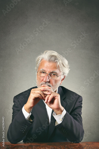 White hairs man with sharp gaze