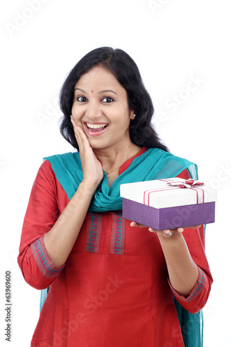 Surprised young woman with gift box