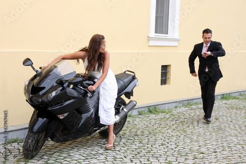 Young wedding couple with motorbike