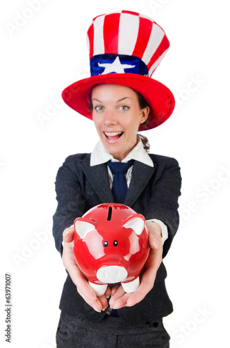 Businesswoman with piggy bank  isolated on white