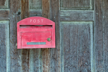 Red wooden mail box on wooden wall