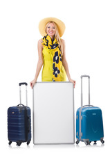 Woman preparing for vacation with suitcases  and blank board iso