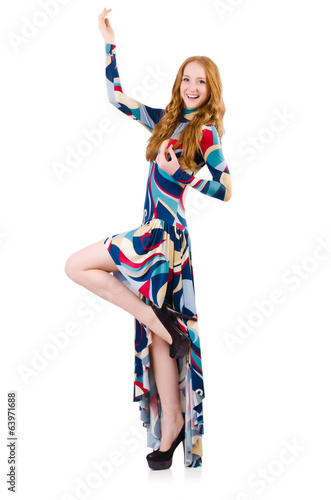 Young  dancing girl in long dress isolated on white