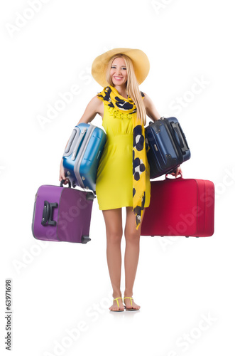Woman with suitcases on summer vacation isolated on white