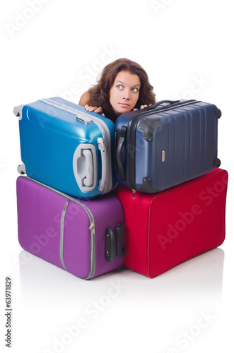 Woman preparing for vacation with suitcases isolated  on white