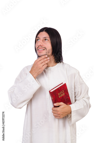 Young priest with bible isolated on white