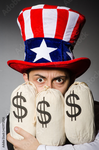 Funny man with american hat and sacks of money