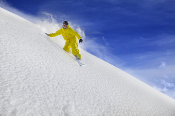Snowboard rider moving down in snow powder