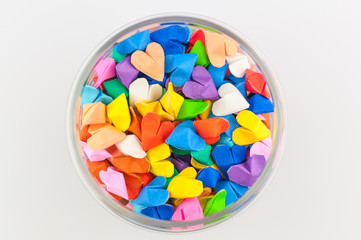 Colorful origami heart in glass