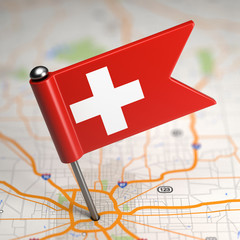 Switzerland Small Flag on a Map Background.