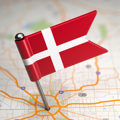 Denmark Small Flag on a Map Background.