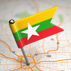 Myanmar Small Flag on a Map Background.