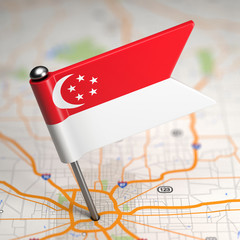 Singapore Small Flag on a Map Background.